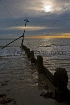 Breakwater construction in seascape at Selsey, Sussex, England