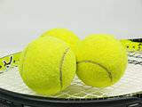 Tennis racket and three balls