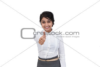 Attractive Asian businesswoman showing a thumbs up