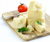 Hard natural parmesan cheese on a wooden board