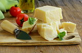 Hard natural parmesan cheese on a wooden board