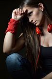 A beautiful young woman with the red headphones