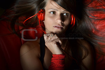 beautiful young woman listening music