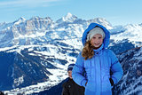 Children on winter  mountain background. Gardena Pass, Italy.
