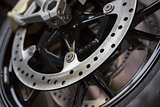 closeup photo of motorcycle wheel brake