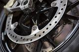 closeup photo of motorcycle wheel brake