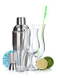 Cocktail shaker, glasses, utensils and lime