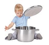 Baby looking inside saucepan