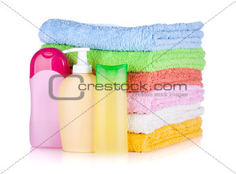 Cosmetics bottles and towels