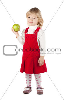 Smiling baby girl with a green apple