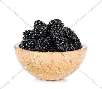 Blackberry in wooden bowl