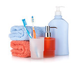 Toothbrushes, shampoo bottles and two towels