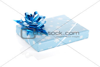 Blue christmas gift box with ribbon and bow