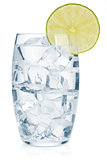 Glass of pure water with ice cubes and lime slice