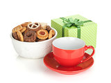 Various cookies, red tea cup and green gift box