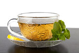 Cup of green tea with lemon and mint