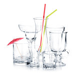Cocktail glasses with drinking straws and umbrella