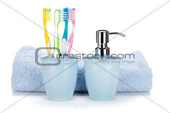 Toothbrushes, liquid soap and towel