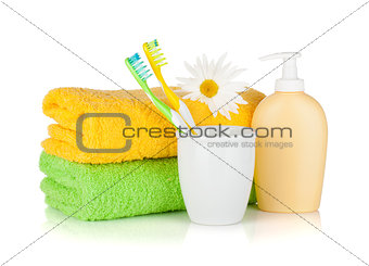 Toothbrushes, liquid soap, towels and flower