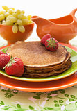 Stack of freshly  traditional pancakes (blini) with strawberries