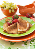 Fresh pancakes (blini) with strawberries