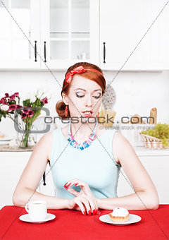 Beautiful woman looking on cake