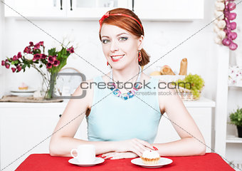 Beautiful smiling woman on the kitchen