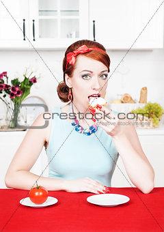 Beautiful woman eating cake