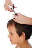 Little boy having a haircut - isolated, closeup