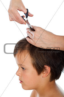 Little boy having a haircut - isolated, closeup