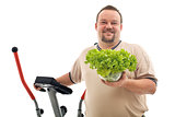 Overweight man with healthy choices - exercise and fresh food