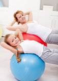 Woman and little girl exercising