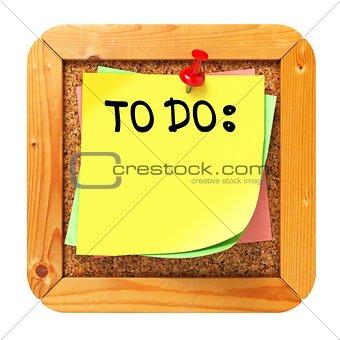 To Do. Yellow Sticker on Bulletin.
