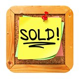Sold!. Yellow Sticker on Bulletin.