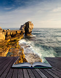 Creative concept image of seascape landscape coming out of pages