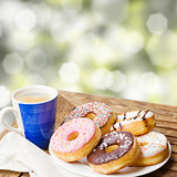 coffee mug and plate of donuts