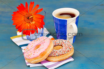 breakfast with black coffee and donuts