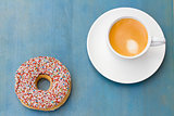 breakfast with fresh coffee and one donut