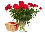 bunch of red roses in vase with gift basket