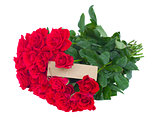 bunch of red roses with empty tag