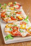 Mini pizzas with mozzarella and cherry tomatoes