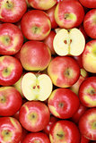 Fresh red apples forming a background