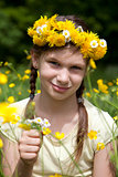 Girl with flowers in her hair on a meadow