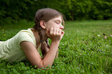 Little girl thinking in a park
