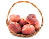 Paraguayos flat peaches in wicker basket