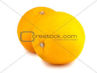 Pair of whole orange fruits