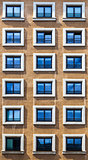 Window Pattern on a Brown Facade