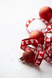 Red gift ribbon and christmas balls
