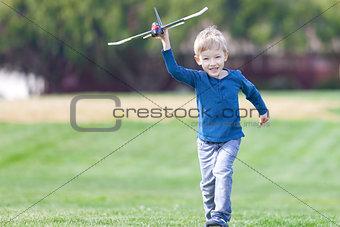 boy playing toy plane