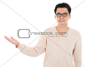 Casual Asian man hand showing blank space